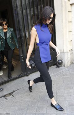 In her shadow: Kendall Jenner leads her mother Kris Jenner out of her Paris hotel as they ...