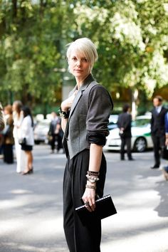 Kate Lanphear in a cropped tweed jacket, YSL pants, and EDDIE BORGO bracelets.