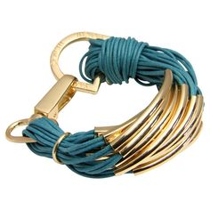 Sale $23. Multi-strand cotton cord bracelet in teal with metal hardware and a lobster clasp.  Product: BraceletConstruction Ma...