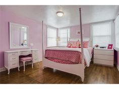 Girly but not over the top // White and pink girl's room with lots of natural light