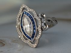 My first DK project! Diamonds, sapphires and bezels - oh my! - by - Antique marquise diamond and sapphire halo engagement ring Informations About My first DK project! Art Deco Diamond, Vintage Diamond, Halo Diamond, Diamond Pendant, Diamond Jewelry, Marquise Diamond, Diamond Rings, Marquise Cut, Bling Bling