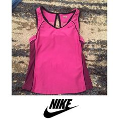 Nike Pink Athletic Tank Top Nike Pink Athletic Tank Top with built in bra. Racerback. Great condition. Trades Low Ball Offers  Please bring the ☮. I do my best to describe things as accurately as possible, ship fast, and give good deals. I hope you'll be a kind buyer. Nike Tops Tank Tops