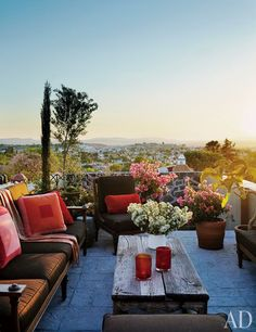 The guest house rooftop terrace at Andrew Fisher and Jeffry Weisman's San Miguel de Allende home has a great view of the city. Michael Taylor Designs furniture, Sunbrella fabric.
