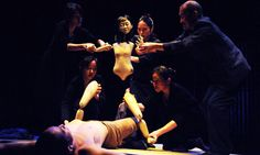I like how there is little light on the puppet, which makes it look more human.    Complicite.