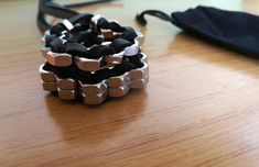 The BLACK. -Handmade braided bracelet with stainless steel hex nuts and black leather cord. -Available in many colours.Find yours here: https://www.etsy.com/shop/hexnutsmade?ref=seller-platform-mcnav -Unisex. -One size.Just tie it up. -Waterproof. -For a glam rock statement look. -Be