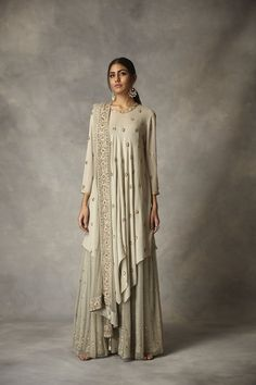 This set features a zardosi gold embroidered highlow kurta with chhita embroidery lining and duppatta. Care: Dry Clean Only Party Wear Indian Dresses, Designer Party Wear Dresses, Dress Indian Style, Indian Fashion Dresses, Pakistani Dresses, Indian Outfits, Fashion Outfits, Sharara Designs, Lehenga Designs