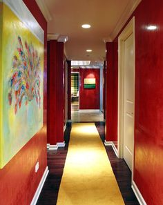 Lake Shore Drive Condo- Hallway::Deb Reinhart Interior Design Group::red glazed walls, gold runner, art, gallery