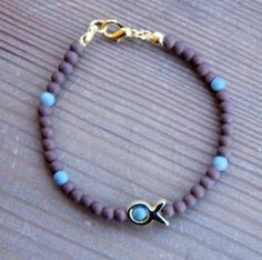 """SALE !!! SALE !!! SALE !!! 10% OFF WITH COUPON CODE """"10OFF"""" FREE SHIPPING WITH COUPON CODE """"FREESHIP"""" OVER $50 Boho braceletFish Bracelet Brown  beaded fish charm by CharmByIA"""
