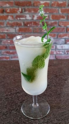 FROHITO - White Rum (2 oz - I used Cana Brava), Lime Juice (1/2 oz), blended with a cup of ice; mint-infused sugar syrup (I used sugarfree Torani and infused using an ISI whipper.) Pour half the syrup in the bottom of a chilled glass, pour frozen mixture over, top with the rest of the syrup and give a light stir. Garnish with fresh mint. This was a HOT DAY and it saved my life!