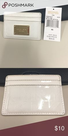 White metallic MK card holder Good used condition with tag! Slight dark color from being in jeans pocket, but functionality is perfect. Please make an offer and I'd be happy to reply! Michael Kors Bags Wallets