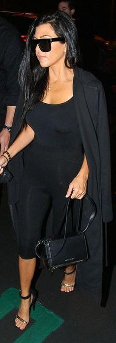 Kourtney Kardashian: Sunglasses and shoes – Celine  Bracelet – Cartier  Purse – Givenchy  Shirt – Wolford