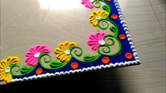 Corner rangoli designs with flowers and with colours by jyoti