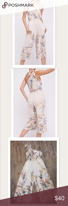 "$128 NEW Free People 'Island Time' Jumpsuit New without tags. Retails for $128 + tax  Adorable!  Ivory floral print combo Asymmetrical  Front slant pockets Soft, lightweight  Size S  Measures approximately: bust across 17.25""  High end department store shelf pull- new without tags. May have had customer contact *Small defect- small tear at the seams under the left arm- very minor. Easy to repair if desired. Refer to photos.   PLEASE ASK ANY QUESTIONS BEFORE PURCHASE, THANKS CHECK OUT MY…"