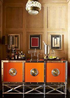 The orange and metal cabinet is genius!