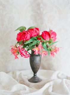 An eye-catching arrangement of peonies, Dragon Wing begonias, and geraniums   Photo by Jodi Miller