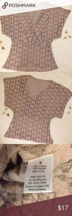 Anthropologie lace blouse NWOT Anthropologie The Addison story dusty mauve colored sheer lace blouse. Faux wrap v neck. Covered buttons along left side at waist. One small spot on front where threads are bunched (see last pic) but it really isn't noticeable unless you are searching for it. Otherwise excellent condition. Never worn except to try on. Looks nice with white tank or camisole underneath. Size small. Questions welcome. Offers welcome. Anthropologie Tops Blouses