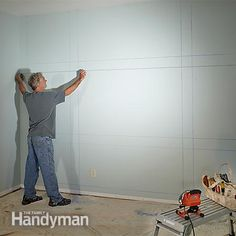 Mark the built-in bookcase and entertainment center plans on the wall. - Showcase Built-In Bookcase Plans: http://www.familyhandyman.com/woodworking/bookcase/showcase-built-in-bookcase-plans/view-all