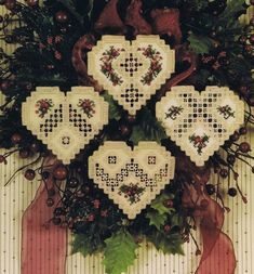 Four lovely Christmas ornaments - hang on your window, Christmas tree or holly wreath as illustrated.