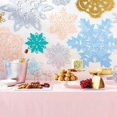 snowflakes to decorate behind a buffet // 10 Times Paper Snowflake Decorations Actually Looked Pretty Fancy Paper Snowflake Patterns, Snowflake Decorations, Paper Snowflakes, Christmas Decorations, Food Decorations, Office Decorations, Decor Ideas, Wedding Decorations, Diy Christmas Snowflakes