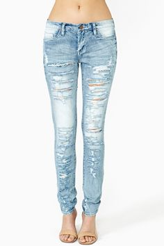These light denim skinny jeans with rips will add cute casual look to any outfit