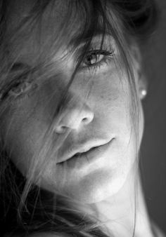 I love the wispy hair, and soft lighting. Black and white. Beautiful.