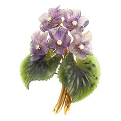 A gold, amethyst, nephrite and diamond brooch, c.1946, fashioned as a posy of violets; violets symbolise modesty in the language of flowers. (Doyle New York)