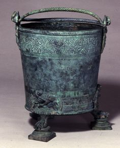Roman wine: Etruscan situla. A Situla is a vessel or bucket to contain fluids. The Romans also used them to serve wine and to mix wine with water or specific flavours to spice up said wine. cast bronze, The Marches,Ascoli Piceno 375BC-350BC, British Museum