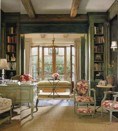 Susan Arnold also incorporated two French bistro tables into her beautiful library's decor.