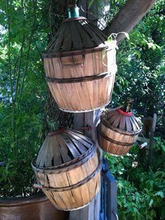 Agnes's brocante, just outside of Aix en Provence, Vintage wine jugs in baskets