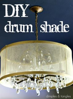 i want to cover my ugly chandelier with a drum shade... hmm i may be able to use this tutorial