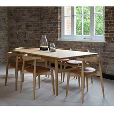 Wegner Elbow Chairs with Dining Table in Loft | Carl Hansen & Son
