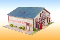 """*NEW* """"Speedy's #Garage"""" Photo Real Scale Building Kit is a complete #scalemodel set that comes ready to trim and assemble.   They are made for 1/64 """"HO"""" #slotcar layouts, specifically #Aurora and #AFX tracks, and """"S"""" #train gauge layouts. Based on the use of real building materials photographed and printed.  Our kits Include: cool illusion rooms or details behind open doors and scale bushes to add even more realism. full color online instructions. #scalebuilding #hobby  #DIY #diorama…"""