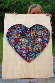 Simple string art for kids. Maybe a large scale collaborative project or smaller scale individual projects.