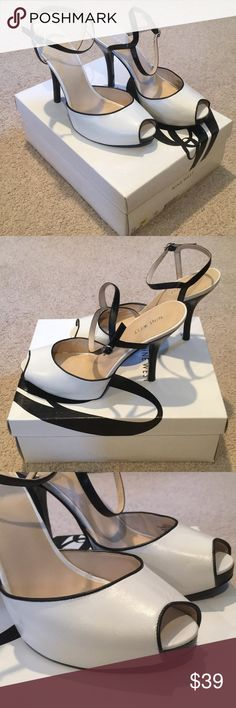 Nine West Frayna Heels Nine West Frayna Heels. White with black trim and ankle strap. 10 medium. Leather/man made upper. Balance man made. Worn once and always stored in original box. Perfect condition! Nine West Shoes Heels