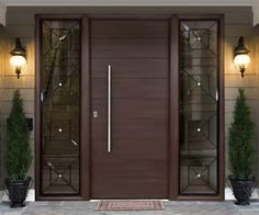 Security door lined with a ribbed aluminum and fixed side panels.