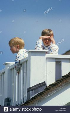 June 14, 1987: Young Prince Harry and Prince William at Guards Polo Club Windsor on the balcony of the Royal box.