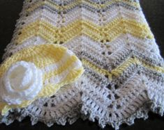 This is a gender neutral, modern colored, ripple baby blanket sure to please the new mom and baby. Whether youre cradling your own little one or looking for the perfect shower gift, this soft baby afghan is a must for the new little one in your life! This afghan measures approximately 28 x 33 and was crocheted using yellow, grey and white acrylic yarn. It is easily cared for: machine wash (cool water, gentle/delicate cycle) and machine dry (low temperature). If you have any comments or ...
