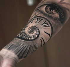 Clock eye tattoo
