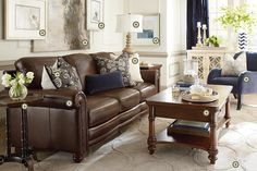 Bassett Rooms We Love   * hamilton sofa :: saddle leather ** in the library with two old fashioned comfy chairs *