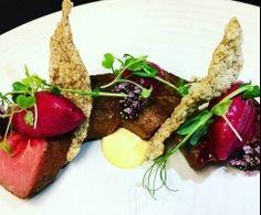 Kawakawa smokes NZ lamb with native herb, beetroot, garlic cream & ancient grain wafers - Chef Dave Anderson