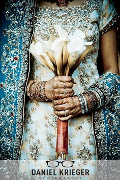 High Saturation flowers. A wonderful photo to show the bride's mehndi, wedding gown, and bouquet in one short. Heavy saturation and sharpness add to the details and intensity of the photo.  Photograph by Daniel Krieger, NYC Wedding Photography