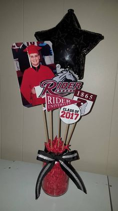 Centerpieces are handmade and can be personalized to include with photos, ribbon, graduation year, school name, sports, colors, etc. Each centerpiece includes glass jar. Please specify when ordering which school and any important details such as colors. Please contact if personal