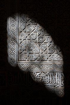 Morning sun rays illuminating Morocco's intricate architecture.