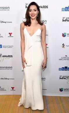 Aubrey Plaza in a white satin slip dress