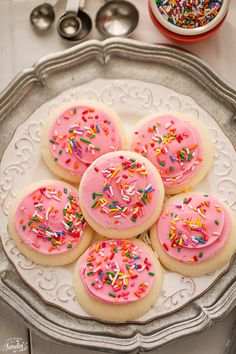 Perfectly Soft Lofthouse Style Frosted Sugar Cookies made from scratch with an easy frosting and full of pretty sprinkles! Best with a tall glass of milk.