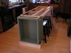How to build a kitchen island using stock cabinets for Building a kitchen island with seating