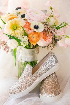 Sparkly wedding shoes and colorful blooms | Dana Cubbage