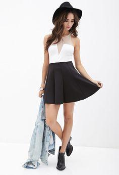 $19, Black Wool Skater Skirt: Forever 21 Scuba Knit Skater Skirt. Sold by Forever 21. Click for more info: https://lookastic.com/women/shop_items/147854/redirect