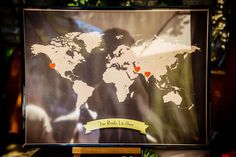 """A map of the world with the words """"Our Roots Live Here"""" with hearts marking the places in which they've lived.  Event Design by Mandy Scott Events."""