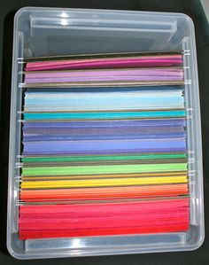 organize construction paper in plastic files. Keep scraps in the green hanging folders that separate the colors. Crates also work. This makes them stackable and portable and easily used by students. No more mess and damaged paper! Great idea!